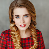 Portrait of a glamorous beautiful smiling girl with bright makeu Stock Photo
