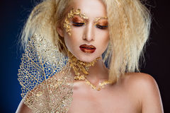 Portrait of a glamorous blonde girl with beautiful Golden makeup stock photography