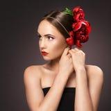 Portrait of glamorous brunette girl over dark background with bu Stock Images