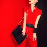 Portrait of a glamorous girl black and red style Royalty Free Stock Images