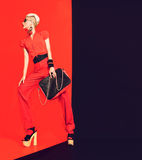 Portrait of glamorous lady Black and red luxurious style Stock Image