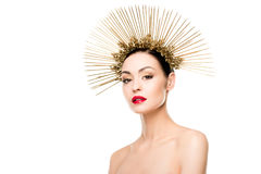 Portrait of glamorous naked model posing in golden headpiece Royalty Free Stock Photography