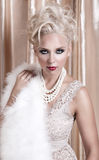 Portrait of glamorous woman. Portrait of glamorous blond woman in cream  lacy dress and  white fur stole Stock Photos