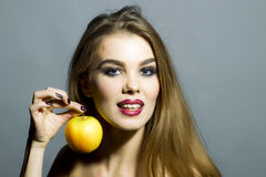 Portrait of glamour girl with the apple Stock Image