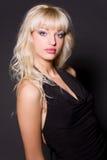 Portrait of glamour girl in black dress. Studio shot stock photos
