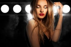 Portrait of glamour young lady with red lips and closed eyes royalty free stock images