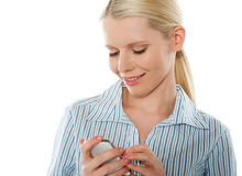 Portrait of a glamourous bussinesswoman texting Royalty Free Stock Photography