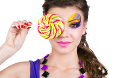 Portrait of a glamourous woman with lollipop Stock Photography