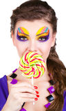 Portrait of a glamourous woman with lollipop Stock Image