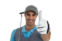 Portrait of golf player showing thumbs up. On white background Royalty Free Stock Photo