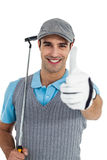 Portrait of golf player showing thumbs up. On white background Royalty Free Stock Images