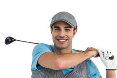 Portrait of golf player taking a shot Stock Photos