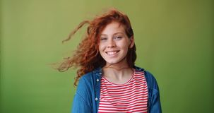 Portrait of good-looking girl with flying hair smiling looking at camera stock video footage