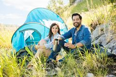 Hispanic couple camping on the mountains Stock Images