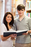 Portrait of good looking students with a book Royalty Free Stock Photo