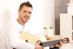Portrait of goodlooking guitarist Stock Photos