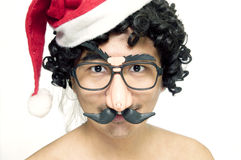 Comical man in santa hat. Portrait of a comical man in Santa hat and comedy eyeglasses on white background Royalty Free Stock Photos