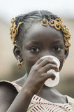 Portrait of gorgeous African girl outdoors drinking water Royalty Free Stock Photo