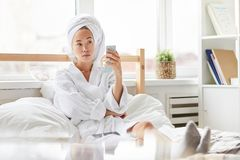 Asian Woman Relaxing in Morning stock photos