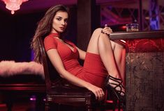 Gorgeous beauty young brunette woman in red dress with glass of Royalty Free Stock Photo