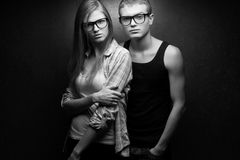 Portrait of gorgeous blond fashion twins in casual shirts Royalty Free Stock Images