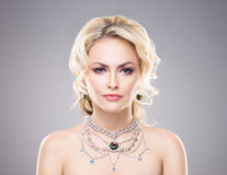 Portrait of gorgeous blond wearing luxury necklace with a gem Stock Photography
