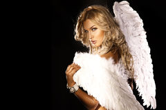 Portrait of gorgeous blonde angel. Portrait of beautiful blonde woman with angels wings. Angel with long curly hair Royalty Free Stock Photo