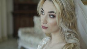 Portrait of gorgeous bride resting on sofa and thinking. 4K stock video