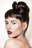 Portrait of gorgeous brunette with elegant makeup Stock Photo