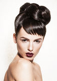 Portrait of gorgeous brunette with elegant makeup Stock Photos
