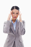 Portrait of a gorgeous businesswoman having a headache Stock Image