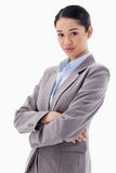 Portrait of a gorgeous businesswoman posing with the arms crosse Stock Images