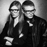 Portrait of gorgeous fashion twins in black clothes Stock Images