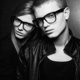 Portrait of gorgeous fashion twins in black clothes Royalty Free Stock Photography