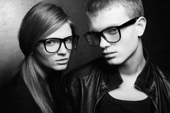 Portrait of gorgeous fashion twins in black clothes Stock Image