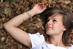 Portrait of the gorgeous girl on the autumn leaf Royalty Free Stock Images