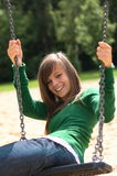 A portrait of a gorgeous girl on the swing Royalty Free Stock Image
