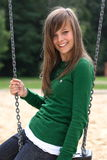 A portrait of a gorgeous girl on the swing Royalty Free Stock Photo