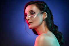 Portrait of gorgeous glam girl, artistic glittering make-up on a Royalty Free Stock Image