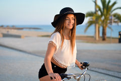 Portrait of gorgeous happy female on a bike ride at the beach on a sunny day Stock Image