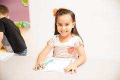 Happy preschooler enjoying school stock photos
