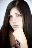 Portrait of gorgeous lady with green eyes thinking Royalty Free Stock Images