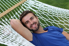Portrait of a gorgeous man laying on a hammock.  Royalty Free Stock Photo