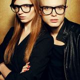 Portrait of gorgeous red-haired fashion twins in black clothes Stock Photos