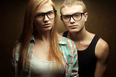 Portrait of gorgeous red-haired fashion twins in casual shirts Stock Photo
