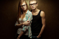 Portrait of gorgeous red-haired fashion twins in casual shirts Royalty Free Stock Photos