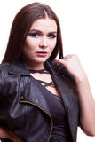 Portrait of gorgeous sexy woman in body and leather jacket. Studio photo. Glamour and fashion Stock Photography