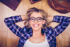 Portrait of gorgeous smiling blonde hipster lying Stock Image