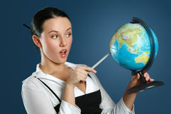 Portrait of a gorgeous teacher with globe Royalty Free Stock Photo