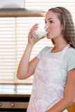 Portrait of a gorgeous woman drinking milk Royalty Free Stock Photos